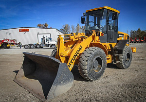 Heavy equipment , trucks and attachments