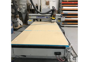 Used Multicam 5′ x 12′ CNC router with auto tool changer, New in 2004