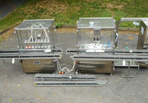 Omas in line vacuum filler and capper