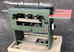 Hunkeler BRLT-100  Spine gluing machine