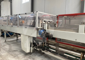 SHRINKWRAPPER WITH FORMING TRAY