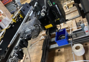 CTM CONVEYOR SYSTEM WITH SPACER AND TOP HOLD DOWN WITH PRINTER APPLICATORI