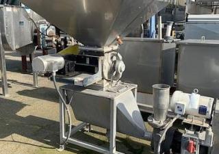 "Stainless Steel Metering Hopper Feeding a Cornell 4"" Hydro food pump."