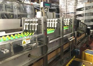 Emballeur de caisses Hartness 2650 à mouvement continu avec modules supplémentaires