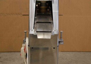 King tablet feeder with screening and dust collection