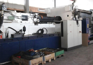 Husky E 2000 - RS 135/115 + Robot Injection moulding machine